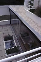 Villa Savoye : the window of the living room seen from the lane to the terrace upper level